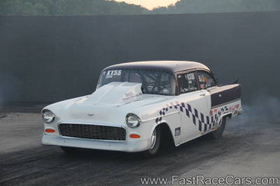 Purple and White 1955 Chevrolet Drag Car with checkered paint