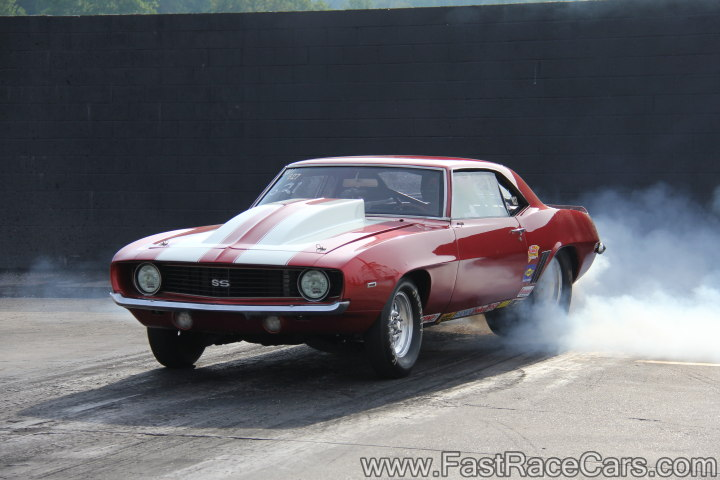 Red CAMARO doing burnout