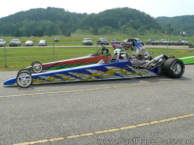 Blue DRAGSTER with green flames down the side